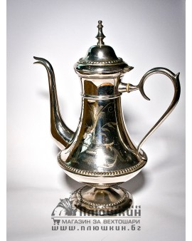 Silver teapot with incrustations