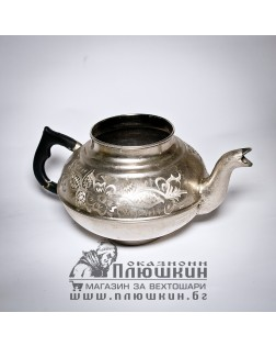 Silver teapot with handmade incrustations